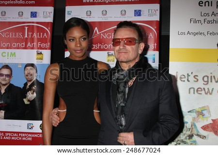 LOS ANGELES - FEB 23:  Naomie Harris, Bono at the LA Italia Opening Night at TCL Chinese 6 Theaters on February 23, 2014 in Los Angeles, CA - stock photo