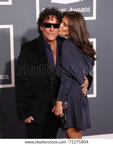 LOS ANGELES - FEB 13: Neal Schon & Ava Fabian arrive at the 2011 Grammy Awards on February 13, 2011 in Los Angeles, CA