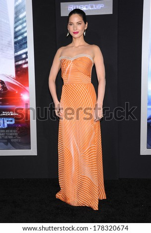 "LOS ANGELES - FEB 10:  Olivia Munn arrives to the ""RoboCop"" Hollywood Premiere  on February 10, 2014 in Hollywood, CA"