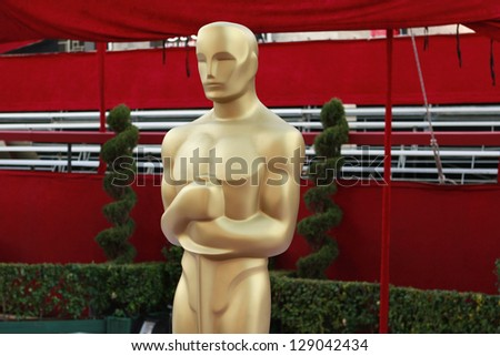 LOS ANGELES - FEB 21: Oscar statue at the arrivals area at the Oscars held at the Dolby Theater in Los Angeles, California on February 21, 2013 - stock photo