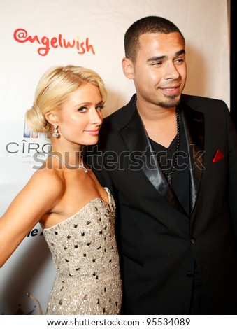 "LOS ANGELES - FEB. 12: Paris Hilton & Afrojack attend the ""Fame At The Mansion"" 2012 Grammy Aterparty hosted by Sean ""Diddy"" Combs held at the Playboy Mansion. Los Angeles, Feb 12, 2012 - stock photo"