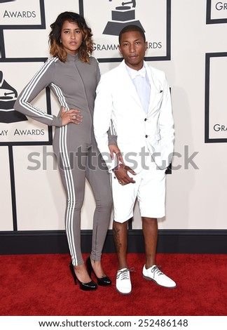 LOS ANGELES - FEB 08:  Pharrell Williams & Helen Lasichanh arrives to the Grammy Awards 2015  on February 8, 2015 in Los Angeles, CA                 - stock photo