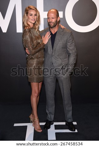 LOS ANGELES - FEB 20:  Rosie Huntington-Whiteley & Jason Statham arrives to the Tom Ford Autumn/Winter 2015 Womenswear Collection Presentation  on February 20, 2015 in Hollywood, CA                 - stock photo
