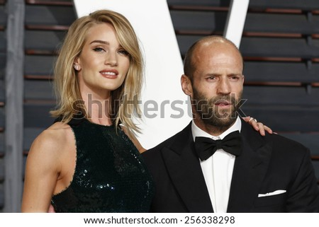 LOS ANGELES - FEB 22:  Rosie Huntington-Whiteley, Jason Statham at the Vanity Fair Oscar Party 2015 at the Wallis Annenberg Center for the Performing Arts on February 22, 2015 in Beverly Hills, CA - stock photo