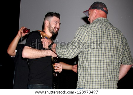 LOS ANGELES - FEB 15:  Steve Austin greeting a fan at a special Q & A screening of 'The Package' at the Laemmle Noho 7 Theaters on February 15, 2013 in North Hollywood, CA