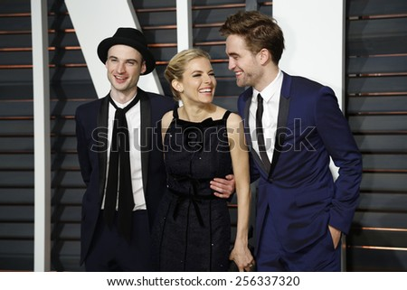 LOS ANGELES - FEB 22:  Tom Sturridge, Sienna Miller, Robert Pattinson at the Vanity Fair Oscar Party 2015 at the Annenberg Center for the Performing Arts on February 22, 2015 in Beverly Hills, CA - stock photo