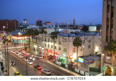 LOS ANGELES - FEB 9, 2014: View of Hollywood Boulevard in sunset. In 1958, the Hollywood Walk of Fame was created in 1958 as a tribute to artists and other significant contributors. - stock photo