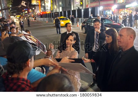 LOS ANGELES - FEBRUARY 4: Actress Eva Green signs autographs at the premiere of 300: Rise of an Empire at the TCL Chinese Theatre, Hollywood on February 4, 2014 - stock photo