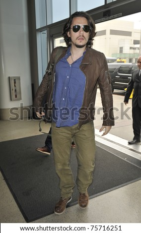 LOS ANGELES - FEBRUARY 15: Singer John Mayer is seen at LAX on February 15, 2010 in Los Angeles, California