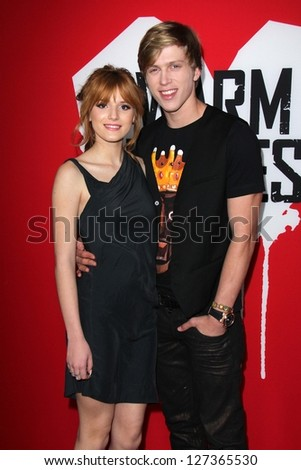 """LOS ANGELES - JAN 29:  Bella Thorne, Tristan Klier arrives at the """"Warm Bodies"""" Los Angeles premiere at the Arclight Hollywood on January 29, 2013 in Los Angeles, CA. - stock photo"""