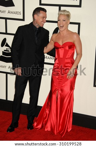 LOS ANGELES - JAN 26:  Carey Hart and wife Pink arrives at the 56th Annual Grammy Awards Arrivals  on January 26, 2014 in Los Angeles, CA                 - stock photo