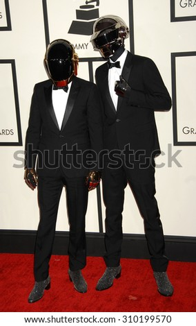 LOS ANGELES - JAN 26:  Daft Punk arrives at the 56th Annual Grammy Awards Arrivals  on January 26, 2014 in Los Angeles, CA                 - stock photo