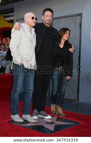 LOS ANGELES - JAN 25:  Evan Handler, David Duchovny, Pamela Adlon at the David Duchovny Hollywood Walk of Fame Star Ceremony at the Fox Theater on January 25, 2016 in Los Angeles, CA - stock photo
