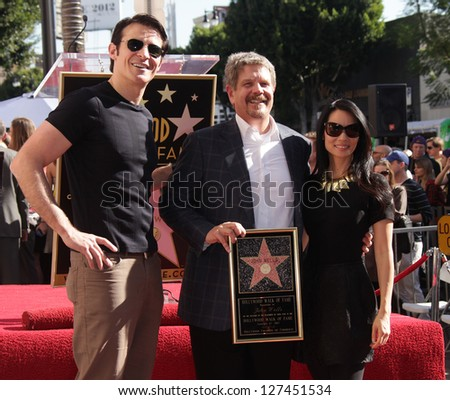 LOS ANGELES - JAN 12:  Goran Visjnic, John Wells & Lucy Liu arriving to Walk of Fame Ceremony for John Wells  on January 12, 2012 in Hollywood, CA - stock photo