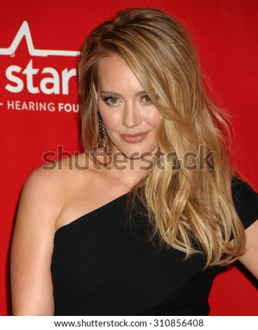 LOS ANGELES - JAN 24:  Hilary Duff arrives at the 2014 MusiCares Person Of The Year Honoring Carole King  on January 24, 2014 in Los Angeles, CA                 - stock photo