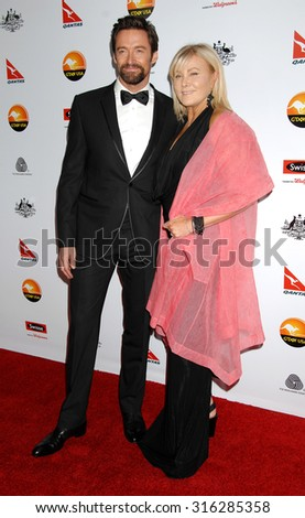 LOS ANGELES - JAN 12 - Hugh Jackman and wife Deborra-Lee Furness arrives at the 2013 GDay USA Los Angeles Black Tie Gala  on January 12, 2013 in Los Angeles, CA              - stock photo