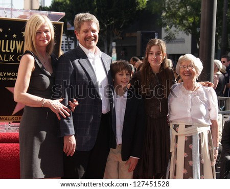 LOS ANGELES - JAN 12:  John Wells & Family arriving to Walk of Fame Ceremony for John Wells  on January 12, 2012 in Hollywood, CA - stock photo