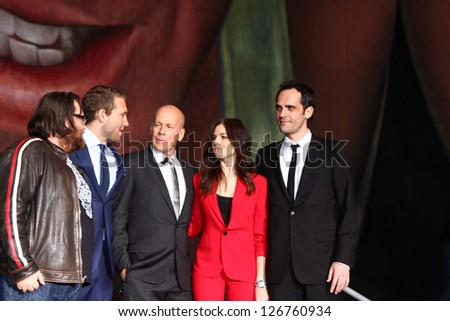 "LOS ANGELES - JAN 31:  (L-R) J Moore, Jai Courtney, B Willis, Yuliya Snigir and Radivoje Bukvic at the 'A Good Day to Die Hard"" mural unveiling  at Fox Studios on January 31, 2013 in Los Angeles, CA."