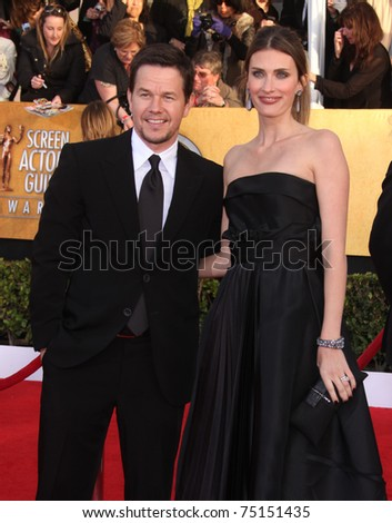 LOS ANGELES - JAN 30:  Mark Wahlberg & Wife arrive at the the SAG Awards 2011 on January 30, 2011 in Los Angeles, CA - stock photo