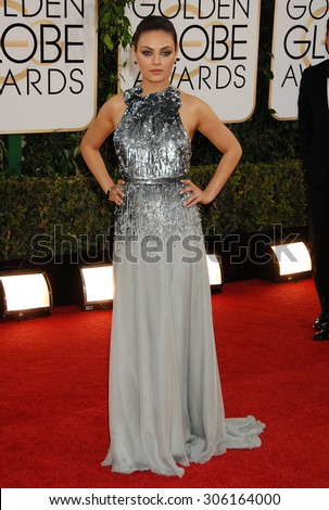 LOS ANGELES - JAN 12:  Mila Kunis arrives to the 2014 Golden Globe Awards  on January 12, 2014 in Beverly Hills, CA                 - stock photo
