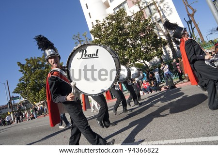 LOS ANGELES - JAN 28: Pearl High School Marching Band perform at Chinatown's Golden Dragon Parade on Jan 28, 2012 in Los Angeles. The Chinese New Year celebrates the Year of the Dragon - stock photo