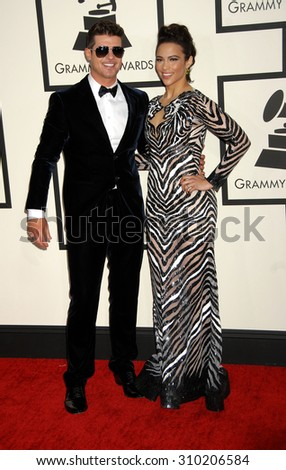 LOS ANGELES - JAN 26:  Robin Thicke and Paula Patton arrives at the 56th Annual Grammy Awards Arrivals  on January 26, 2014 in Los Angeles, CA                 - stock photo