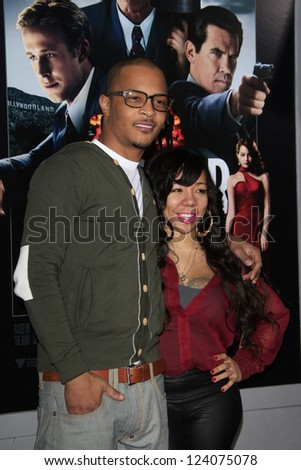 "LOS ANGELES - JAN 7: T.I., Tameka ""Tiny"" Harris at Warner Bros. Pictures' 'Gangster Squad' premiere at Grauman's Chinese Theater on January 7, 2013 in Los Angeles, California - stock photo"