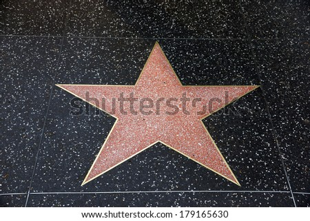 LOS ANGELES - JANUARY 23: A blank star in Hollywood Walk of Fame on January 23, 2014 in Los Angeles, CA. There are more than 2,400 five-pointed stars which attract about 10 million visitors annually  - stock photo
