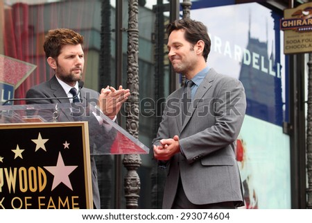 LOS ANGELES - JUL 1:  Adam Scott, Paul Rudd at the Paul Rudd Hollywood Walk of Fame Star Ceremony at the El Capitan Theater Sidewalk on July 1, 2015 in Los Angeles, CA - stock photo