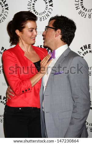 """LOS ANGELES - JUL 16:  Bellamy Young, Dan Bucatinsky arrives at  """"An Evening With Web Therapy: The Craze Continues..."""" at the Paley Center for Media on July 16, 2013 in Beverly Hills, CA - stock photo"""
