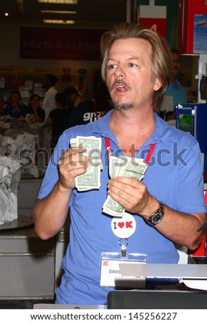 "LOS ANGELES - JUL 3:  David Spade clerks at K-Mart to support March of Dimes and promote the ""Grown Ups 2"" movie at the K-Mart on July 3, 2013 in Los Angeles, CA"