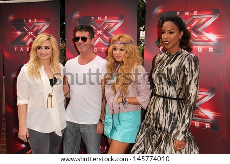 "LOS ANGELES - JUL 11:  Demi Lovato, Simon Cowell, Paulina Rubio, Kelly Rowland at the ""X-Factor"" Season 3 Photo Call at the Galen Center on July 11, 2013 in Los Angeles, CA - stock photo"