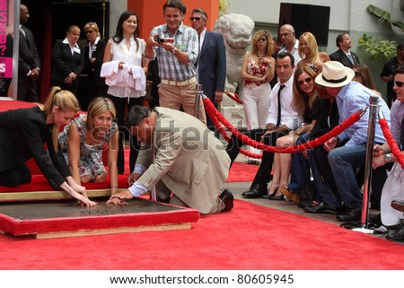 LOS ANGELES - JUL 7:  Jennifer Aniston, Justin Theroux (White shirt, black tie and hair) at the Jennifer Aniston Handprint & Footprint Ceremony at Grauman's Chinese on July 7, 2011 in Los Angeles, CA