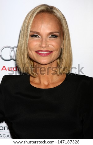 "LOS ANGELES - JUL 22:  Kristin Chenoweth arrives at ""An Evening with Carol Burnett"" at the Academy of Television Arts and Sciences on July 22, 2013 in No. Hollywood, CA"