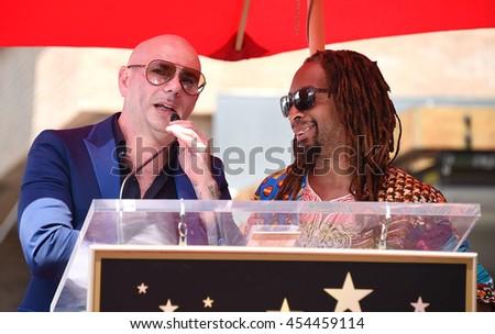 LOS ANGELES - JUL 15:  Pitbull aka Armando Christian Perez & Lil Jon arrives to the Walk of Fame honors Pitbull on July 15, 2016 in Hollywood, CA                 - stock photo
