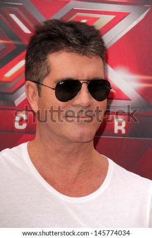 "LOS ANGELES - JUL 11:  Simon Cowell at the ""X-Factor"" Season 3 Photo Call at the Galen Center on July 11, 2013 in Los Angeles, CA - stock photo"