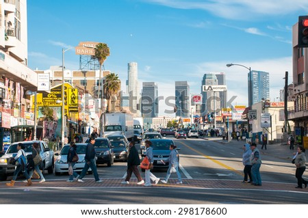 LOS ANGELES - JULY 15, 2015: People crossing the street in Downtown of Los Angeles, on July 15, 2015 - Los Angeles, CA - stock photo