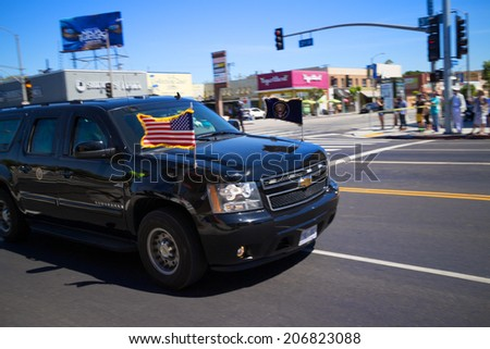 LOS ANGELES - July 23, 2014: President Barack Obama's motorcade crossing corner of 3rd Street and La Brea Avenue during presidential visit to LA. - stock photo