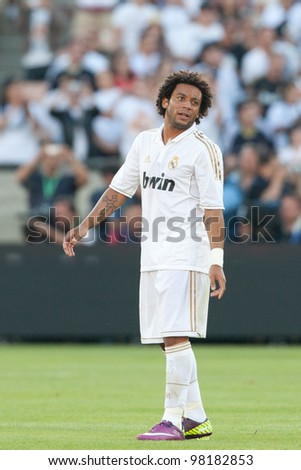 LOS ANGELES - JULY 16: Real Madrid C.F. D Marcelo #12 during the World Football Challenge game between Real Madrid & the Los Angeles Galaxy on July 16 2011 at the Los Angeles Memorial Coliseum in Los Angeles, CA.
