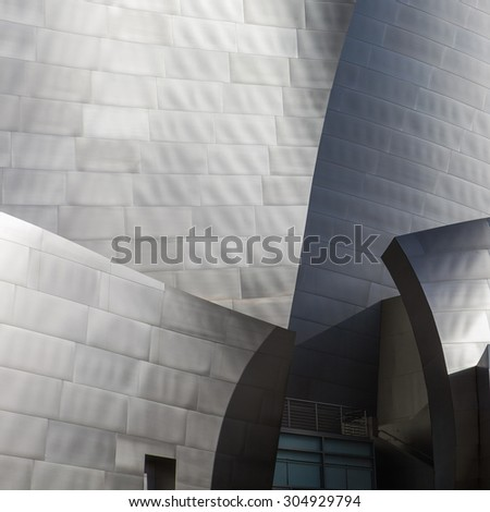 LOS ANGELES - JULY 26: Walt Disney Concert Hall in Los Angeles, CA on July 26, 2015. The hall was designed by Frank Gehry and is a major component in the Los Angeles Music Center complex. Metallic - stock photo