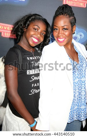 LOS ANGELES - JUN 23:  Alijah Kai Haggins, Tichina Arnold at the 100th DCOM Adventures In Babysitting LA Premiere Screening at the Directors Guild of America on June 23, 2016 in Los Angeles, CA - stock photo