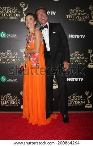 LOS ANGELES - JUN 22:  Amelia Heinle, Peter Bergman at the 2014 Daytime Emmy Awards Arrivals at the Beverly Hilton Hotel on June 22, 2014 in Beverly Hills, CA - stock photo