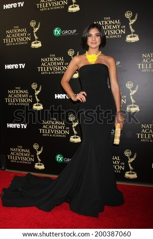 LOS ANGELES - JUN 22:  Camila Banus at the 2014 Daytime Emmy Awards Arrivals at the Beverly Hilton Hotel on June 22, 2014 in Beverly Hills, CA - stock photo