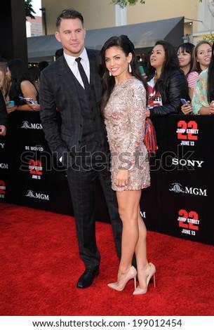 "LOS ANGELES - JUN 09:  Channing Tatum & Jenna Dewan-Tatum arrives to the ""22 Jump Street"" World Premiere  on June 09, 2014 in North Hollywood, CA                 - stock photo"