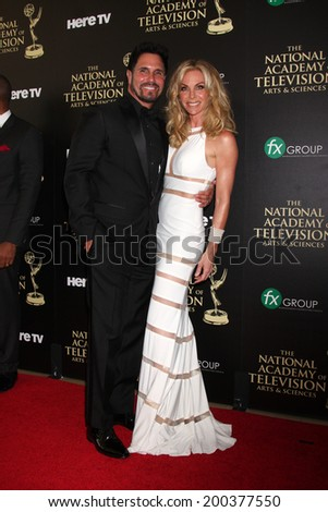 LOS ANGELES - JUN 22:  Don Diamont, Cindy Ambuehl at the 2014 Daytime Emmy Awards Arrivals at the Beverly Hilton Hotel on June 22, 2014 in Beverly Hills, CA - stock photo