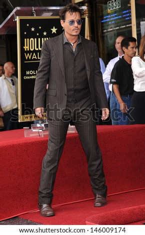 LOS ANGELES - JUN 23:  Johnny Depp arrives to the Walk of Fame Honors Jerry Bruckheimer  on June 23, 2013 in Hollywood, CA                 - stock photo