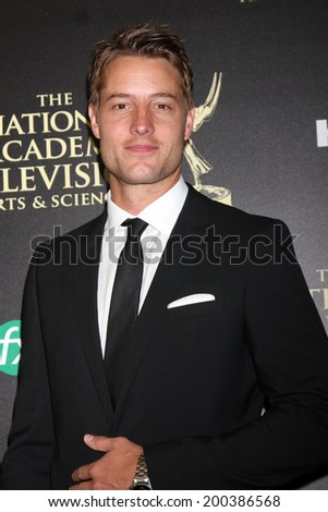 LOS ANGELES - JUN 22:  Justin Hartley at the 2014 Daytime Emmy Awards Arrivals at the Beverly Hilton Hotel on June 22, 2014 in Beverly Hills, CA - stock photo