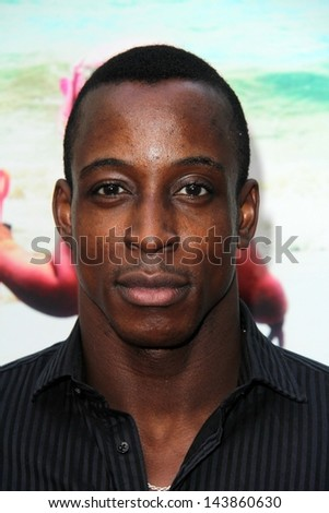 """LOS ANGELES - JUN 12:  Shaka Smith arrives at the """"Unacceptable Levels"""" Premiere at the ArcLight Hollywood Theaters on June 12, 2013 in Los Angeles, CA - stock photo"""