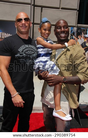 "LOS ANGELES - JUN 23:  Vin Diesel, Tyrese Gibson, Tyrese's daughter at the ""Fast & Furious - Supercharged"" Ride Press Event at the Universal Studios on June 23, 2015 in Universal City, CA"