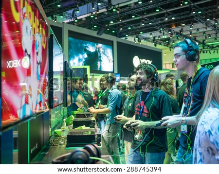 LOS ANGELES - June 16: Gamers playing demo XBOX games at E3 2015 expo. Electronic Entertainment Expo, commonly known as E3, is an annual trade fair for the video game industry - stock photo